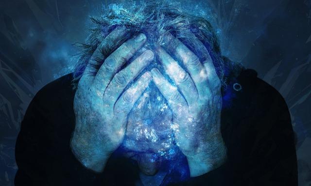 muž s bolestí hlavy